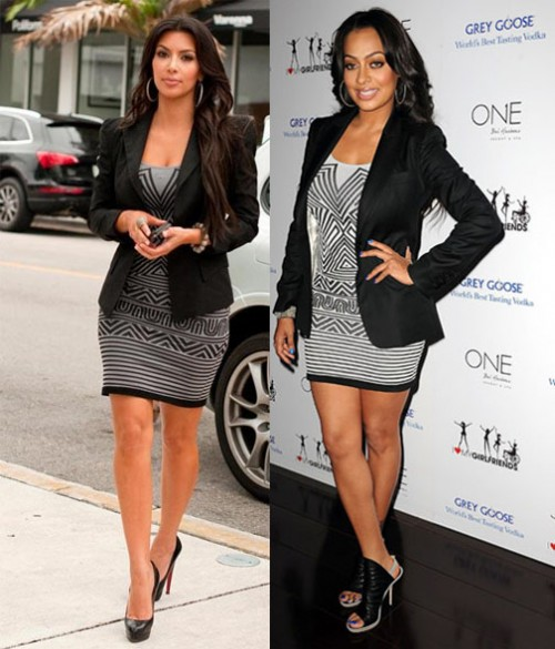 kim-kardashian-and-lala-vasquez-wearing-the-same-gray-dress-with-aztex-pattern-and-horitontal-stripes-both-paired-with-a-black-blazer-500x585